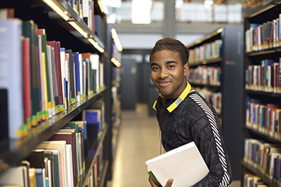 Teen in a library